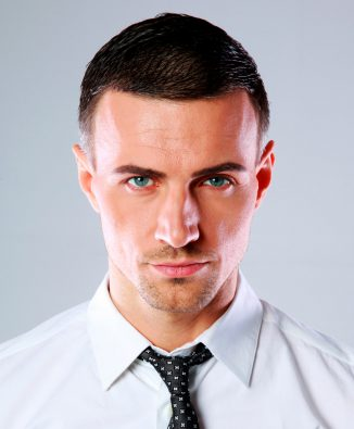 portrait-of-a-confident-man-over-gray-background-PDL3Q9F.jpg
